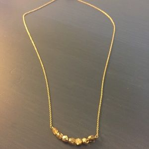 Gold necklace with shimmering gold beads